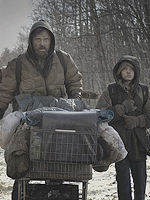 (from left) Viggo Mortensen and Kodi Scott-McPhee in The Road