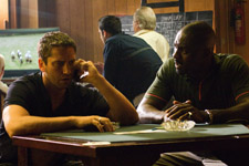 (from left) Gerard Butler and Idris Elba in RocknRolla