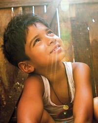 Ayush Mahesh Khedekar in Slumdog Millionaire
