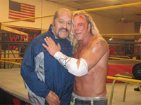 (from left) Afa the Wild Samoan and Mickey Rourke on the set of The Wrestler